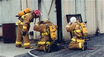 Firefighters at the Village's burn tower training.